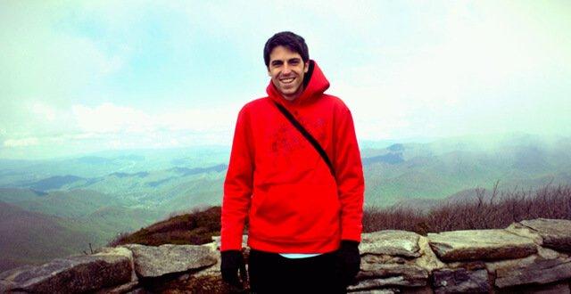 Nathan Oxenfeld smiles while atop a mountain
