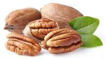 Pecans whole and shelled on a white background