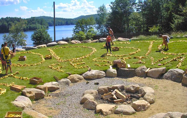 Woodstock Fruit Festival staff members and volunteers spell the festival name using bananas