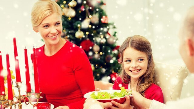 A family shares salad during a Christmas meal