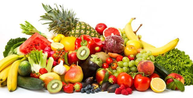 A spread of fruits and vegetables on white background