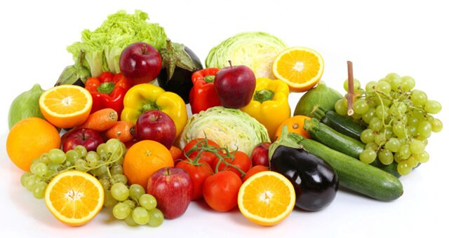 A spread of fruits and vegetables on a white background