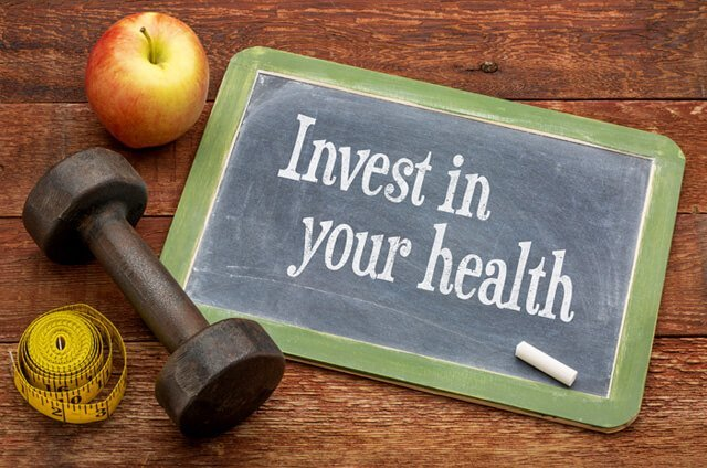 """Invest in your health"" on a chalkboard"