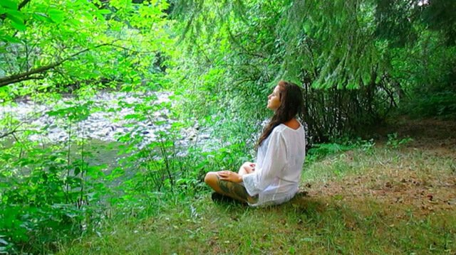 Tarah Millen meditates outside