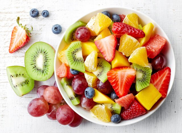 A bowl of colorful fruits