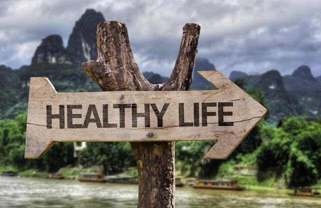 """The words """"healthy life"""" etched into a wooden sign"""