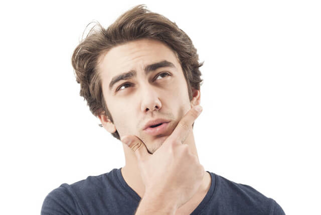 A man rubs his chin while deep in thought