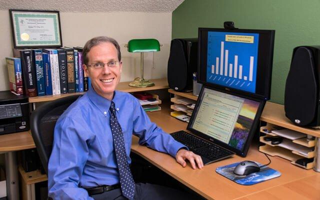 Rick Dina at his desk in 2015
