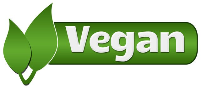 """The word """"vegan"""" adorned with green leaves"""