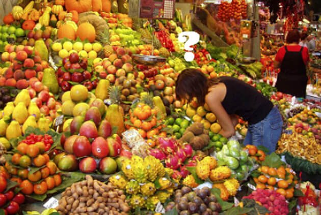 A woman shops for fruits