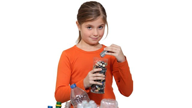 A young girl recycles batteries with plastic bottles in view