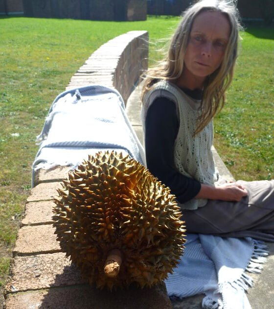 Kvetoslava Martinec sits beside durian in the sun
