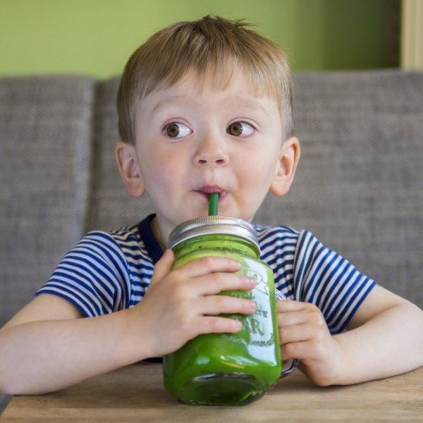 Ball Mason Jars and mason jar accessories - boy sipping green smoothie - Fruit-Powered Store