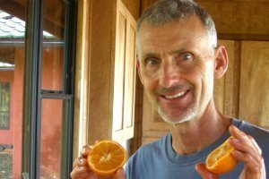 Don Weaver holding oranges - Fruit-Powered