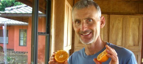 Don Weaver holding oranges - Fruit-Powered