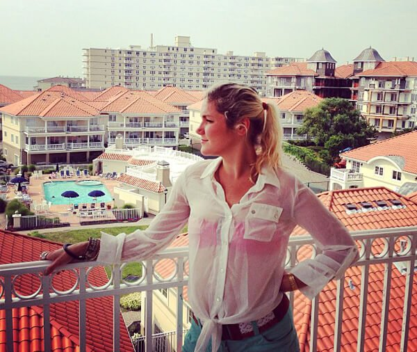 Anastasia Voss looks out across a city from a balcony