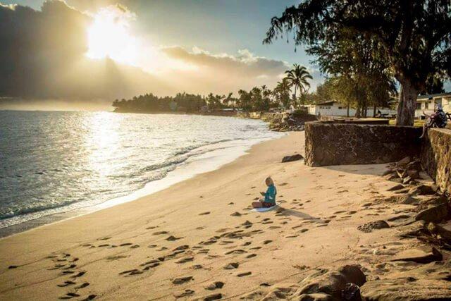 Anastasia Voss relaxes on a sun-splashed beach