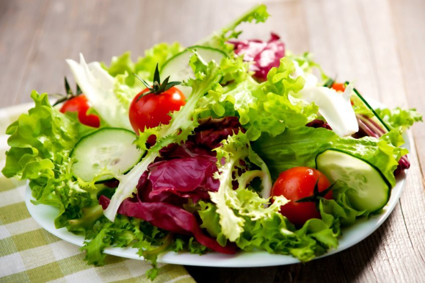 Lettuce, tomatoes and cucumber on a salad plate - Fruit-Powered