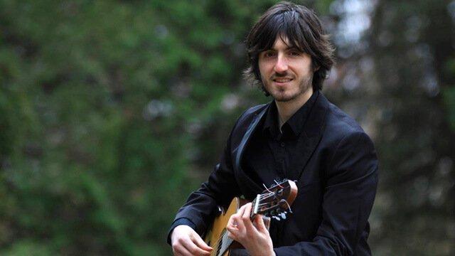 Francesco Barone plays guitar outdoors