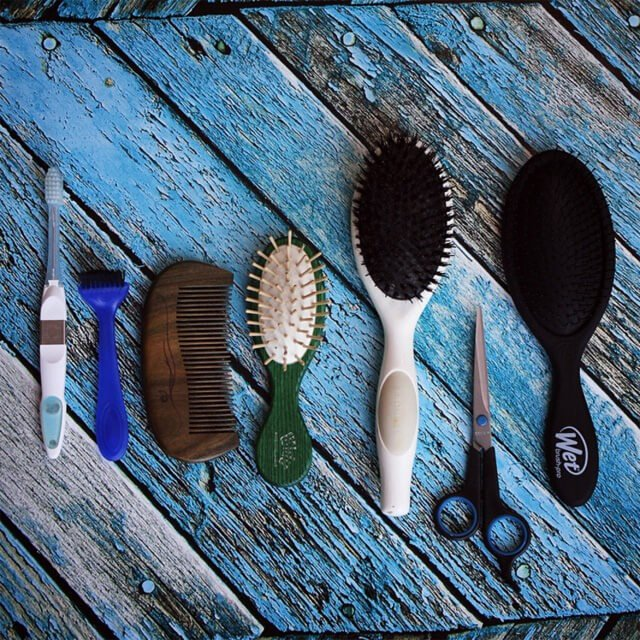 Vegan brushes and combs on wooden planks