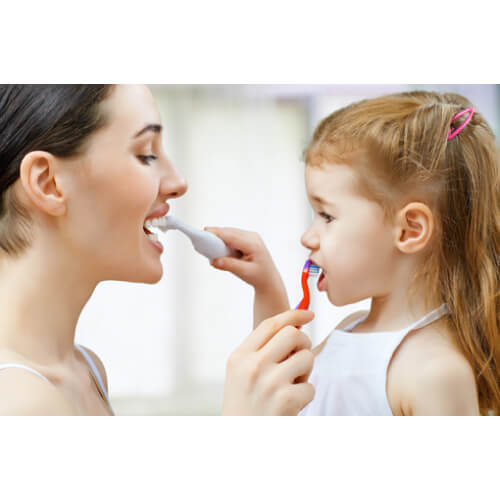Uncle Harry's Natural Products Whitening Toothpaste Polish - mother and child brushing teeth - Fruit-Powered Store