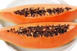Papaya halves on a white plate