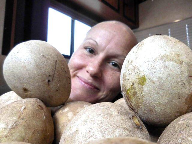 Tasha Lee amid a stack of fruits