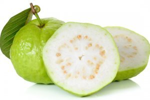 Guava whole and halved on white background