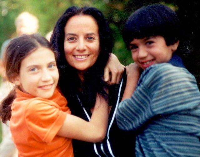 Karen Ranzi hugs her children