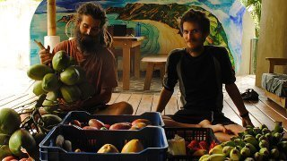 Mads and Mikkel Gisle Johnsen with an abundant supply of fruits
