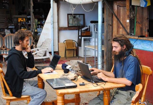 Mads and Mikkel Gisle Johnsen work on laptops in La Palma