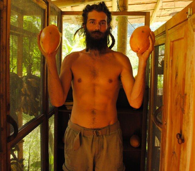 Mikkel Gisle Johnsen holds fruits up high