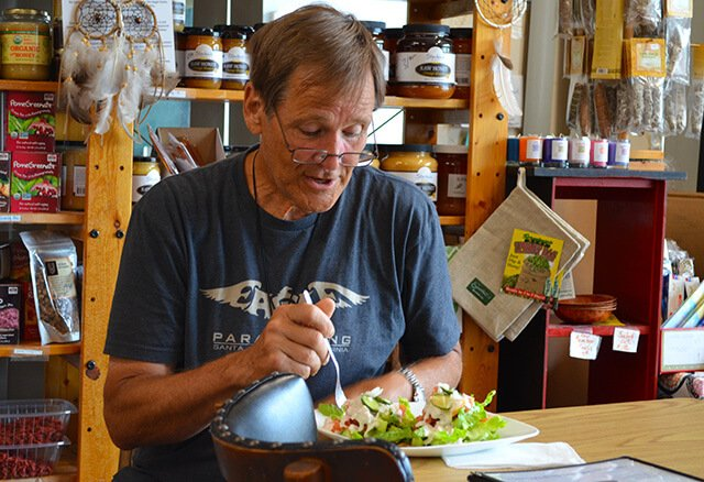 Don Croft enjoys a Cheezeberger Sandwich at Arnold's Way