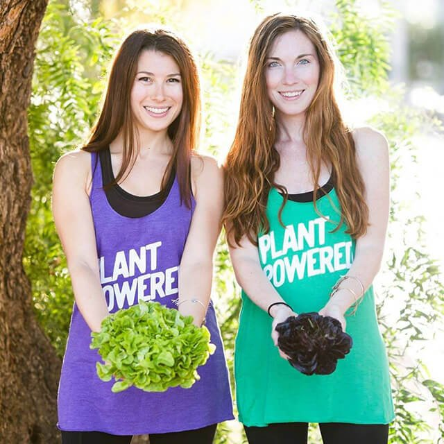 Rawthenticity's Lori Weiss and Nicole Gregg hold lettuce outside