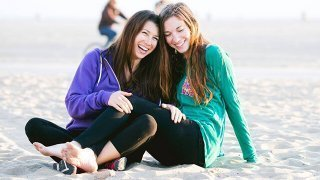 Rawthenticity's Lori Weiss and Nicole Gregg relaxing on a beach