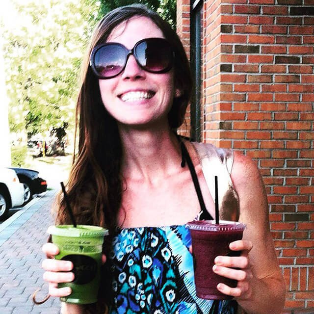 Rawthenticity's Nicole Gregg holds a pair of smoothies