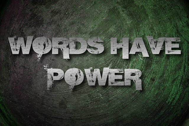 """Words Have Power"" written on a green-and-gray canvas"