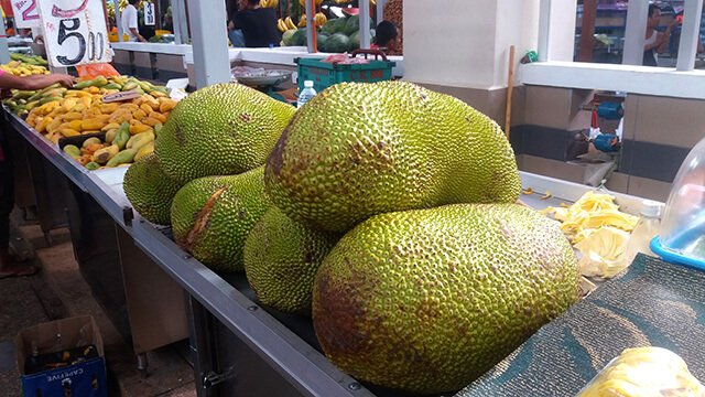 Jackfruit is stacked at a market
