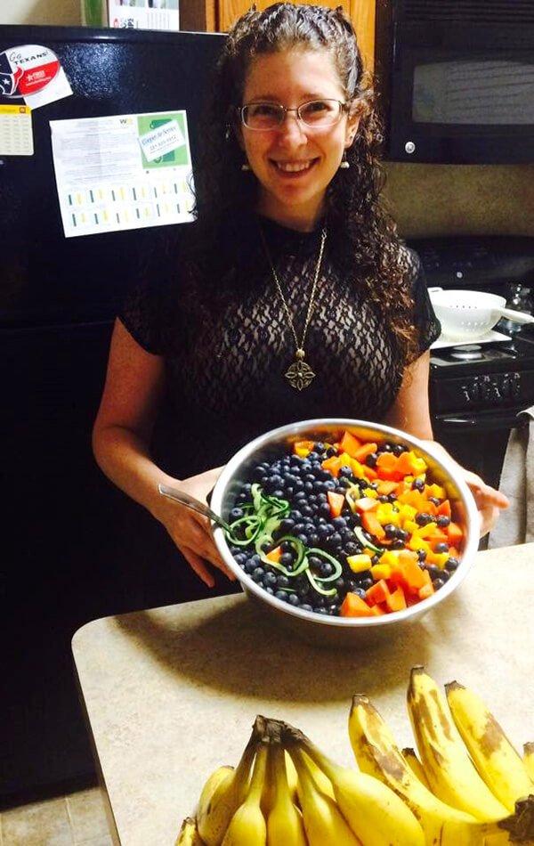 rebecca-rosenberg-holding-a-raw-food-dish