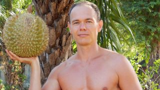 Petr Cech hoists a durian in Koh Lanta