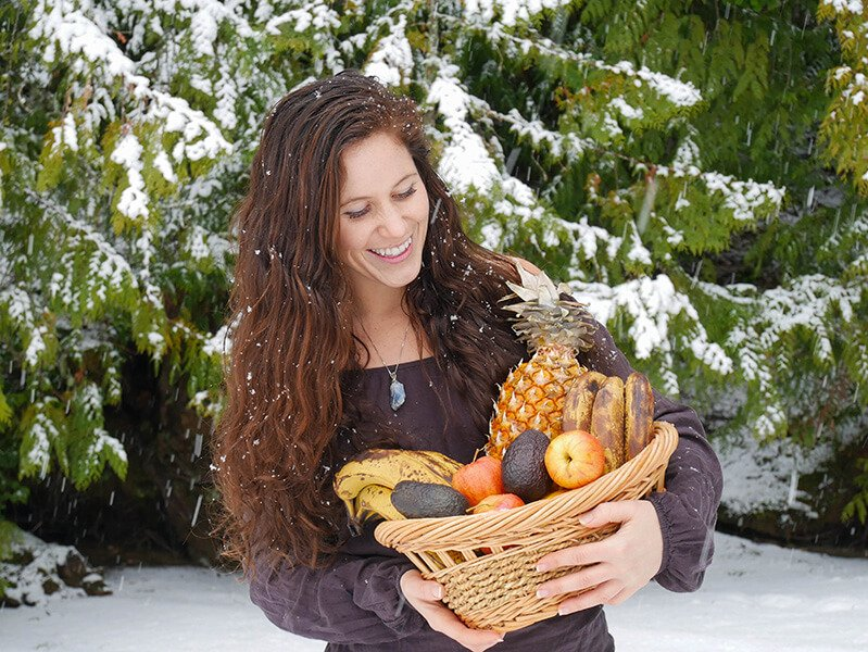 Tarah Millen holds a basket of fruit