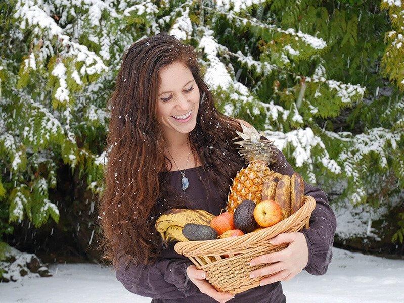 Tarah Millen holds a basket of fruit