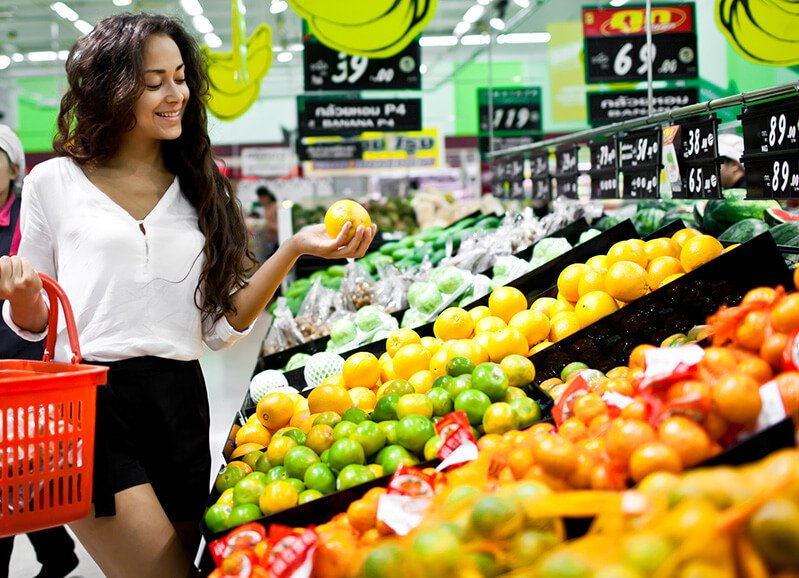 A woman shops in a produce aisle