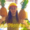 Peter Csere holds pineapples with TerraFrutis.com emblazoned on the photo