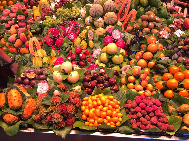 A display of colorful fruits from around the world at a market in Europe