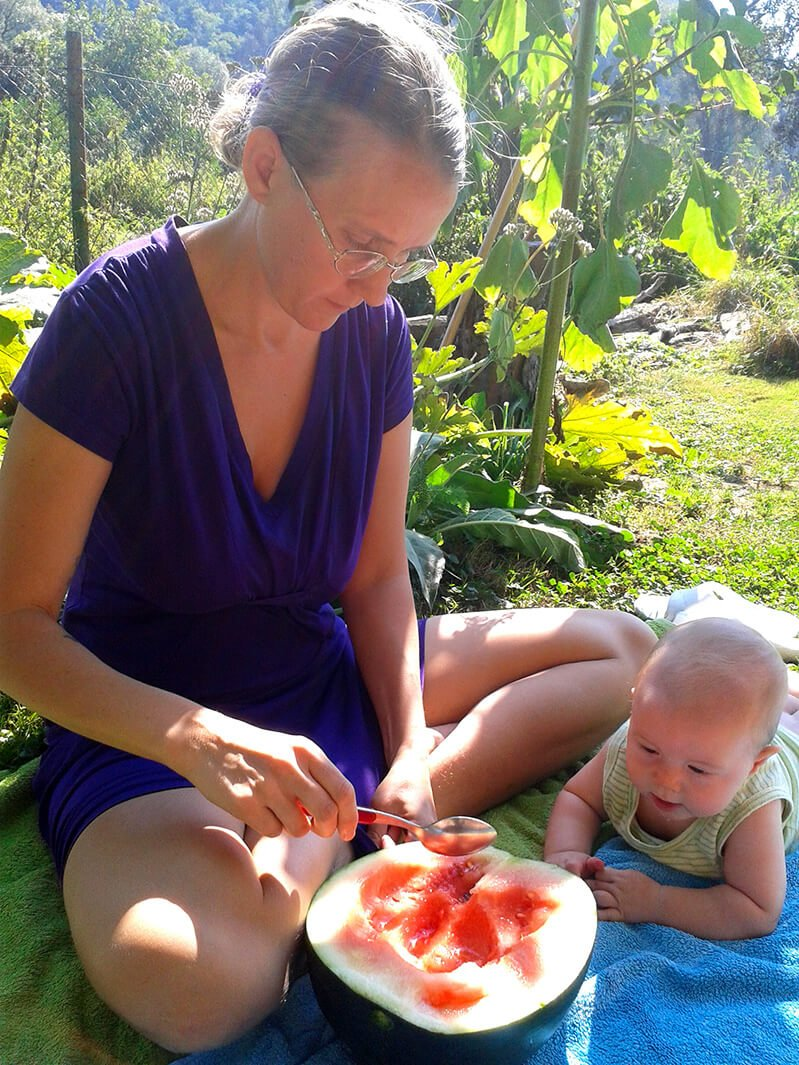 Alexandra Cech eating a watermelon with her and Petr Cech's baby