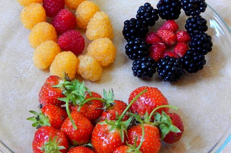 Brightly colored berries on a plate