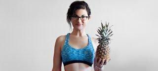 Melissa Raimondi holds a pineapple