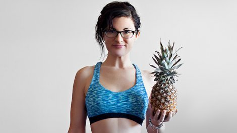 Melissa Raimondi holds a pineapple