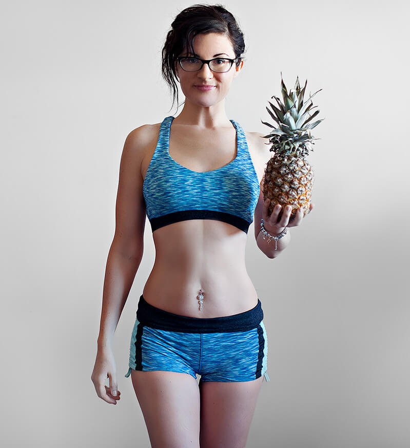 Melissa Raimondi raises a pineapple